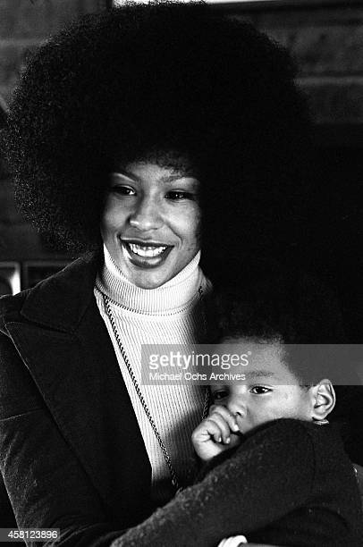 Marguerite Simpson, wife of O. J. Simpson, poses for a portrait at home while holding her son Jason on January 8, 1973 in Los Angeles, California.