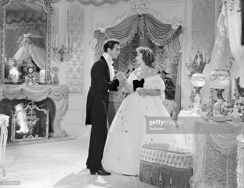 Greta Garbo Handing Flower To Robert Taylor In Camille Pictures