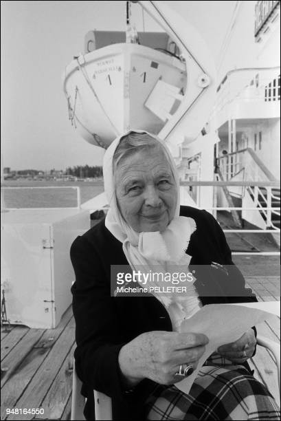 """Marguerite Yourcenar with the telegram of the French President aboard the French liner """"Jean Mermoz"""" on a Carribbean cruise. ."""