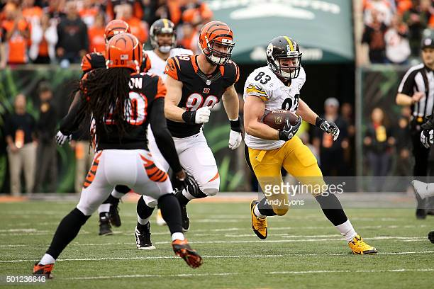 Margus Hunt of the Cincinnati Bengals chases after Heath Miller of the Pittsburgh Steelers during the second quarter at Paul Brown Stadium on...