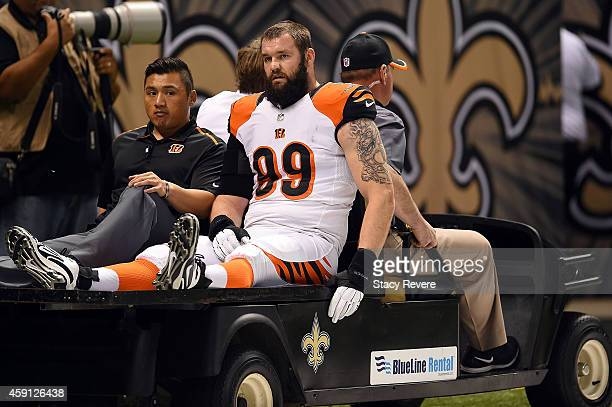 Margus Hunt of the Cincinnati Bengals leaves the field with an injury during a game against the New Orleans Saints at the Mercedes-Benz Superdome on...