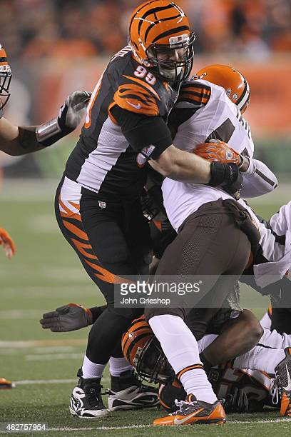 Margus Hunt of the Cincinnati Bengals makes the tackle on Ben Tate of the Cleveland Browns during their game at Paul Brown Stadium on November 6,...