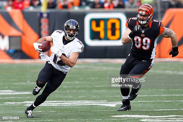 Margus Hunt of the Cincinnati Bengals pursues Michael Campanaro of the Baltimore Ravens during the first quarter at Paul Brown Stadium on January 1,...
