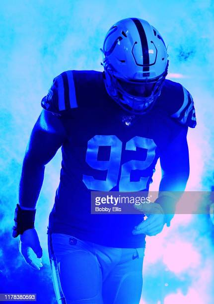 Margus Hunt of the Indianapolis Colts is introduced before the start of the game against the Oakland Raiders at Lucas Oil Stadium on September 29,...