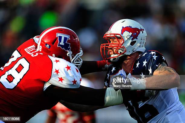 Margus Hunt of the North squad works against Jordan Mills of the South squad during the first half of the Senior Bowl at Ladd Peebles Stadium on...