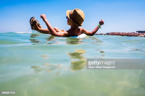 Mari boy floating in inflatable ring in ocean