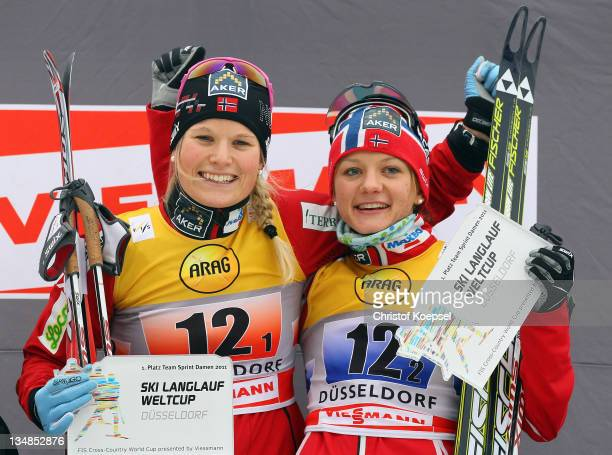 Mari Eide and Maiken Caspersen of Norway celebrate their victory on the podium after winning the 6x 0,8 kilometer women's team sprint of the FIS...