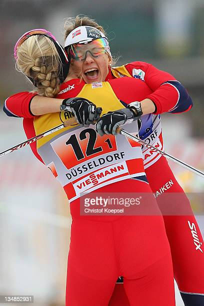 Mari Eide and Maiken Caspersen of Norway celebrate their victory after winning the 6x 08 kilometer women's team sprint of the FIS Cross Country World...