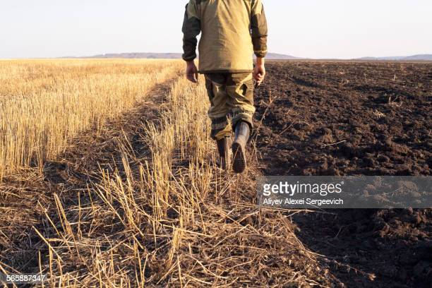 Mari farmer walking in crop fields