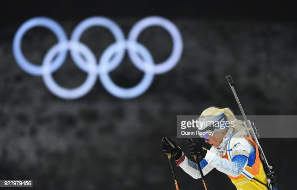 Mari Laukkanen of Finland races past the Olympic Rings during the Women's 4x6km Relay on day 13 of the PyeongChang 2018 Winter Olympic Games at...