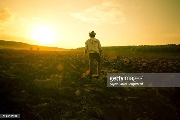 Mari man standing in rural field