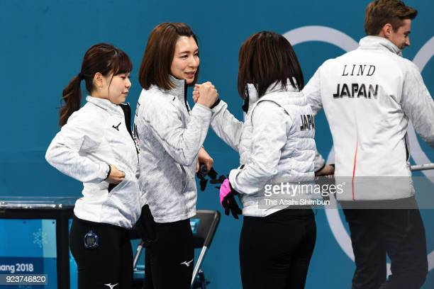 Mari Motohashi of Japan shakes hands with her team mates prior to the Curling Womens' bronze Medal match between Great Britain and Japan on day...