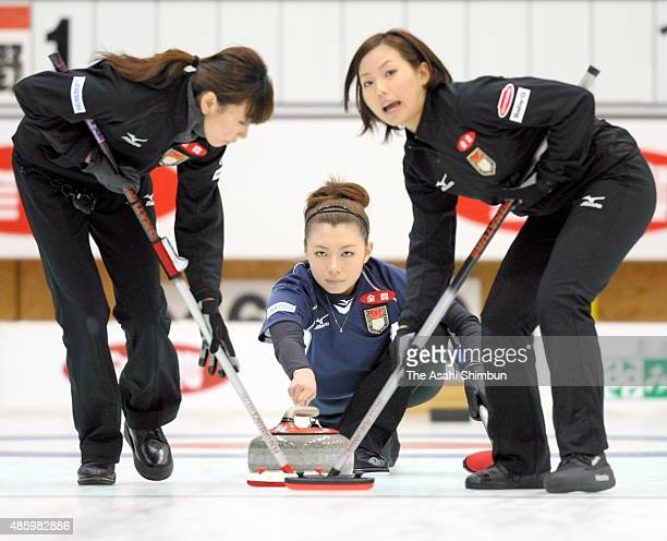 Mari Motohashi of Team Aomori delivers a stone during the Curling Vancouver Olympic Japan team deciding tournament at Aomori City Sports Complex on...