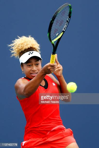 Mari Osaka of Japan returns a shot to Whitney Osuigwe of the United States during Day 4 of the Miami Open Presented by Itau at Hard Rock Stadium on...