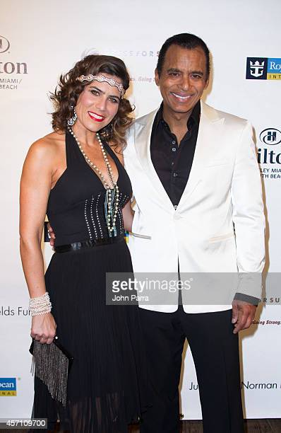 Mari Secada and Jon Secada attend Dress for Success Miami Celebrates 20th Anniversary at The Rusty Pelican on October 11 2014 in Key Biscayne Florida