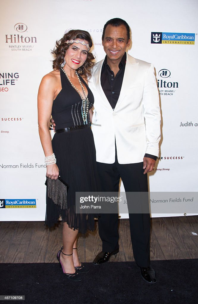Mari Secada and Jon Secada attend Dress for Success Miami Celebrates 20th Anniversary at The Rusty Pelican on October 11, 2014 in Key Biscayne, Florida.