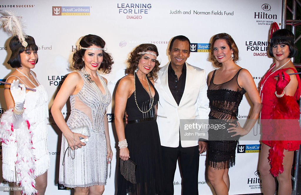 Mari Secada, Jon Secada and Karent Sierra attend Dress for Success Miami Celebrates 20th Anniversary at The Rusty Pelican on October 11, 2014 in Key Biscayne, Florida.