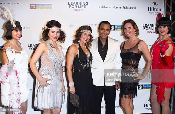Mari Secada Jon Secada and Karent Sierra attend Dress for Success Miami Celebrates 20th Anniversary at The Rusty Pelican on October 11 2014 in Key...