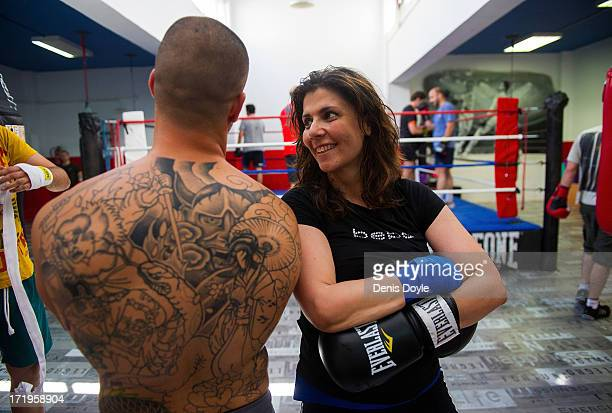 Mari Sol Alcala a free lance television producer chats with her boxing trainer Dani Gombau at a boxing gym on June 28 2013 in Madrid Spain Spanish...