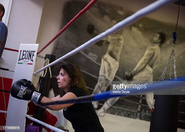 Mari Sol Alcala a freelance television producer listens to her boxing trainer Dani Gombau at a boxing gym on June 27 2013 in Madrid Spain Spanish...