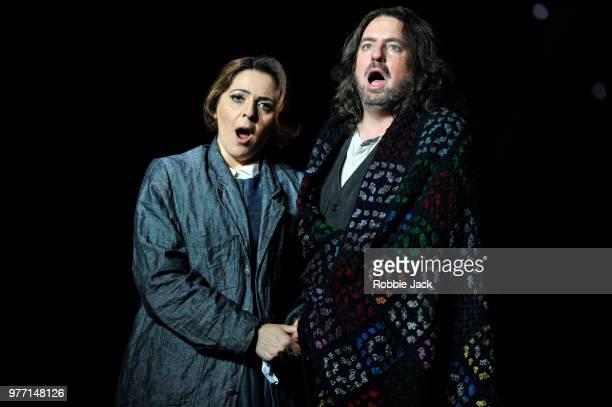 Maria Agresta as Mimi and Matthew Polenzani as Rodolfo in the Royal Opera's production of Giacomo Puccini's La Boheme directed by Richard Jones and...