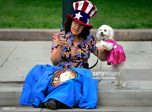 Maria Alaniz and Juky watch along Broadway as the Memorial Day Parade and the 15th Annual Memorial Day Tribute takes place in downtown Denver leading...