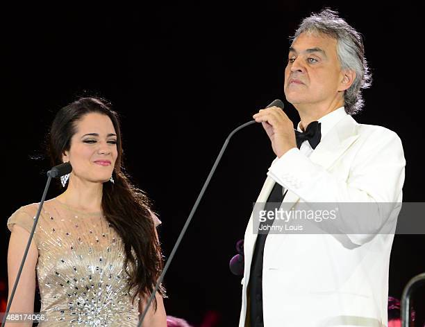 Maria Aleida and Andrea Bocelli onstage perform during the Miami Beach 100 Centennial Concert on March 26 2015 in Miami Beach Florida