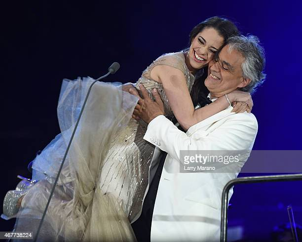 Maria Aleida and Andrea Bocelli perform onstage during the Miami Beach 100 Concert on March 26 2015 in Miami Beach Florida
