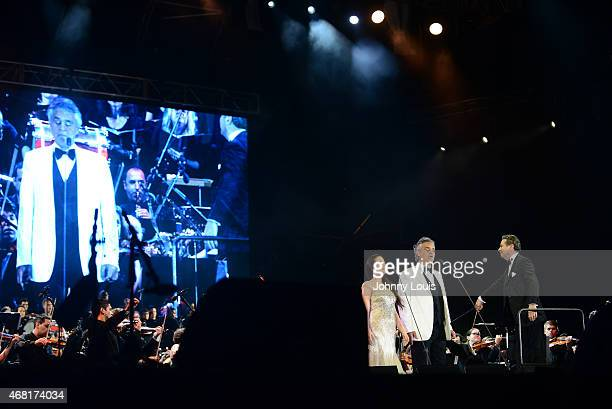 Maria Aleida Andrea Bocelli and conductor Eugene Kohn onstage perform during the Miami Beach 100 Centennial Concert on March 26 2015 in Miami Beach...