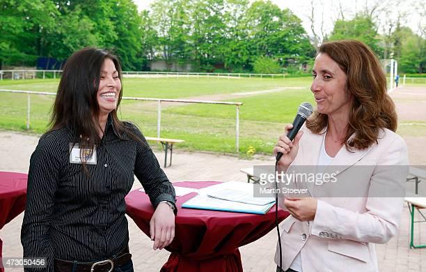 Maria Ali of TSV Wandsetal and Minister Of State For Migration Refugees And Integration Aydan Oezoguz Visits TSV Wandsetal on May 12 2015 in Hamburg...