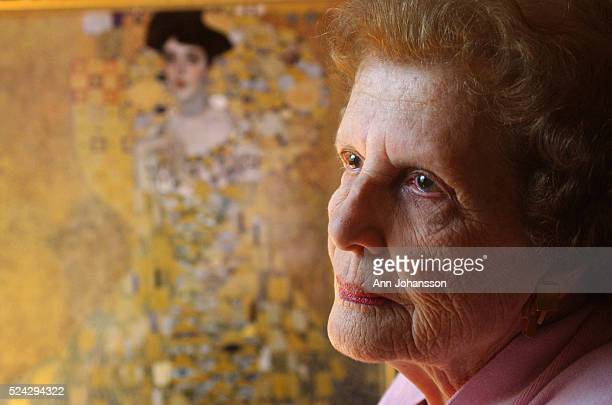 Maria Altmann niece of Adele and Ferdinand BlochBauer poses next to a reproduction of the Gustav Klimt painting of her aunt Adele in her home in Los...