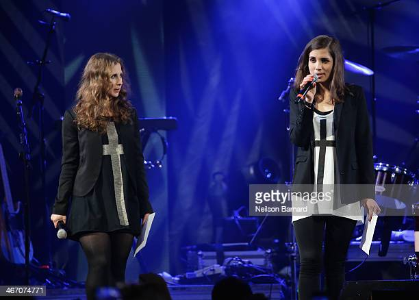 Maria Alyokhina and Nadezhda Tolokonnikova of Pussy Riot speak onstage at the Amnesty International Concert presented by the CBGB Festival at...