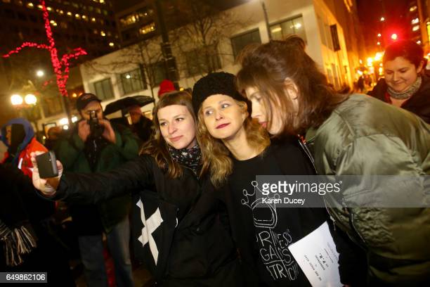 Maria Alyokhina from the feminist rock band Pussy Riot poses for a photo with a fan a rally at Westlake Center on March 8 2017 in Seattle Washington...