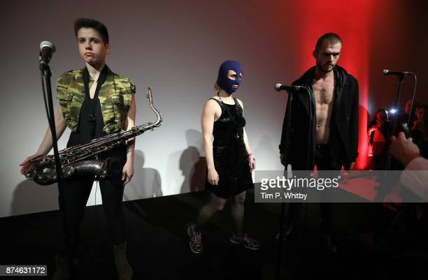 Maria Alyokhina of Pussy Riot makes a protest performance as part of a new exhibition 'Art Riot' at the Saatchi Gallery on November 15 2017 in London...