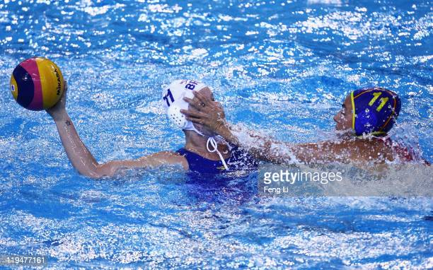 Maria Amaro of Brazil is challenged by Maria Garcia Godoy of Spain in the Women's Water Polo first preliminary round match between Brazil and Spain...