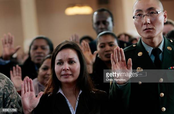 Maria Anne Pilgrim originally from Canada and Yong Shin orginally of Korea take the Oath of Allegiance from Department of Homeland Security Secretary...
