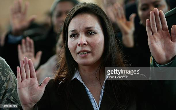 Maria Anne Pilgrim originally from Canada cries as she takes the Oath of Allegiance from Department of Homeland Security Secretary Janet Napolitano...