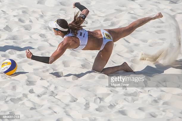 Maria Antonelli of Brazil dives for the ball during semifinal match of the 2014 FIVB Beach Volleyball World Tour on May 11 2014 in Puerto Vallarta...