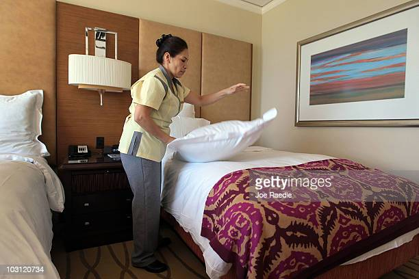 Maria Antonieta a housekeeper at the RitzCarlton Key Biscayne hotel prepares a room for a new occupant on July 27 2010 in Key Biscayne Florida...
