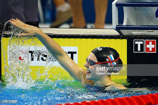 Maria Astashkina celebrates winning the Women's 50m Breaststroke final on day eleven of the Baku 2015 European Games at the Baku Aquatics Centre on...