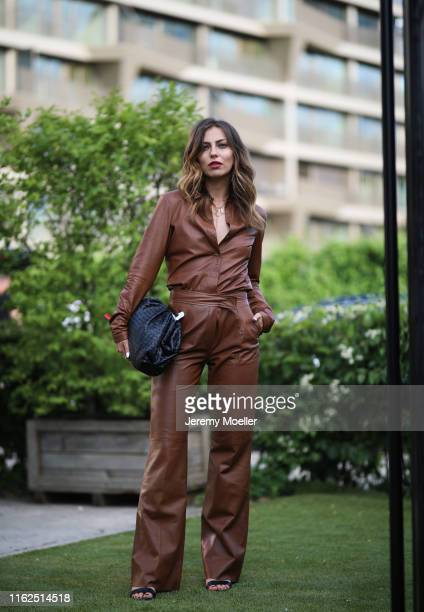 Maria Astor wearing Bottega Veneta bag and Riani jumpsuits on July 03 2019 in Berlin Germany