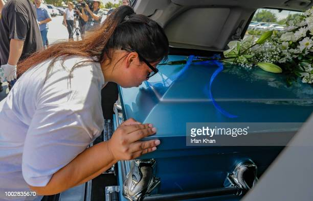 Maria Barron kisses goodbye the casket carrying her nephew 10yearold Anthony Avalos on July 20 2018 in Quartz Hills California Anthony Avalos is the...