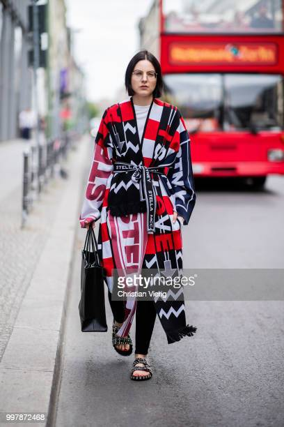 Maria Barteczko is seen wearing a patchwork knit coat Stella McCartney black skinny jeans Acne Studios black studded sandals Givenchy black logo...