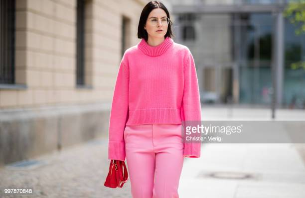 Maria Barteczko is seen wearing a pink oversized cashmere sweater Celine pink cropped wool trousers Celine red plateau sandals Steve madden red mini...