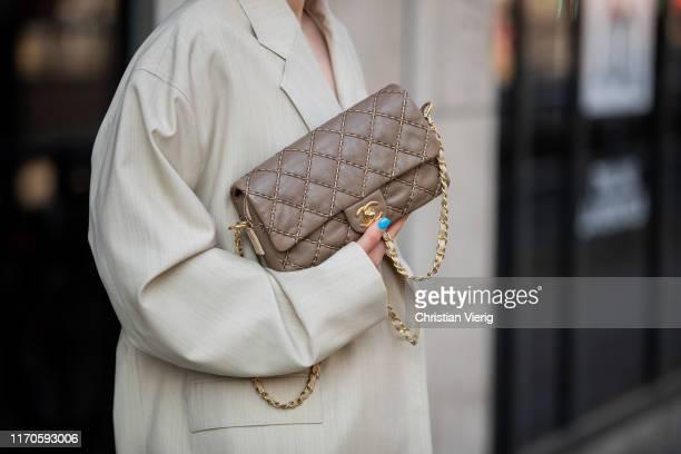 Maria Barteczko is seen wearing beige oversized blazer Nehera green slip dress Zara brown bag Chanel on August 25 2019 in Duesseldorf Germany