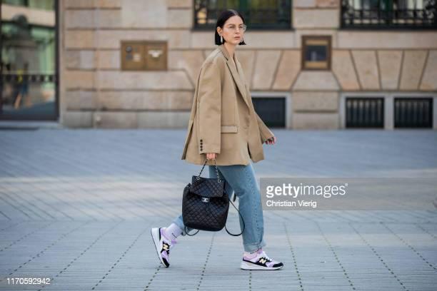Maria Barteczko is seen wearing beige oversized blazer The Frankie Shop black ribbed top Zara high waist belted jeans The Frankie Shop white socks...