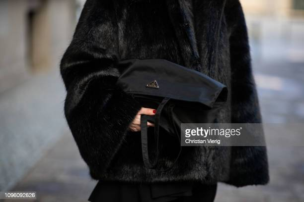 Maria Barteczko is seen wearing black faux fur jacket Toteme black nylon shopper Prada during the Berlin Fashion Week Autumn/Winter 2019 on January...