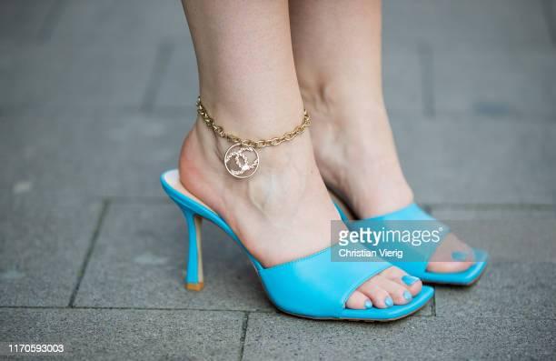Maria Barteczko is seen wearing blue sandals Bottega Veneta gold logo anklet Chanel on August 25 2019 in Duesseldorf Germany