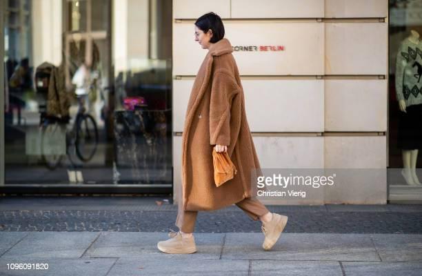 Maria Barteczko is seen wearing brown teddy coat Max Mara, brown sweater Joseph, brown trousers COS, brown plateau sneaker Zara, brown velvet pouch...