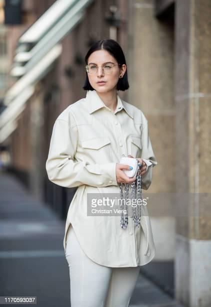 Maria Barteczko is seen wearing cream white leather shirt Papèr Moon white pants Zara white mini chain bag KARA on August 25 2019 in Duesseldorf...